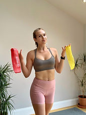 Female fitness Instructor smiling with resistance bands