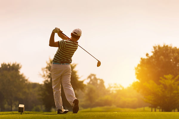 Golfers hit sweeping golf course in the