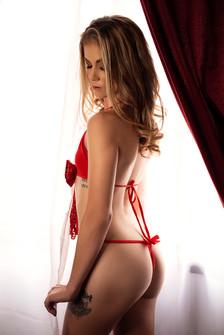 boudoir red lingerie at window