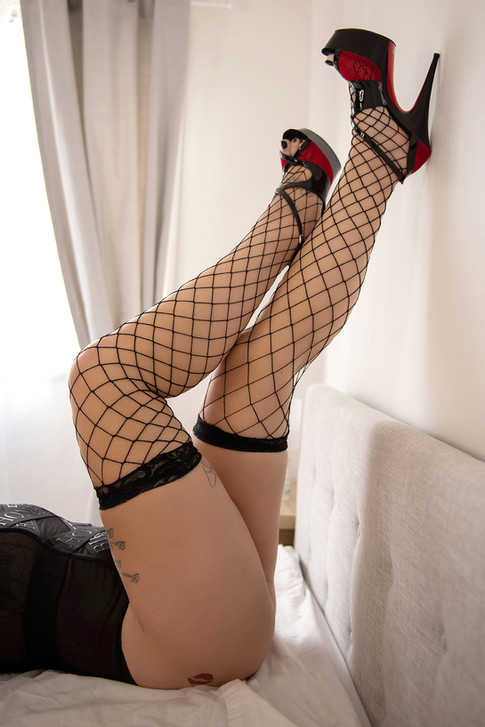 stockings and heels legs up wall boudoir