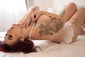 sensual boudoir pose tattoos and pearls