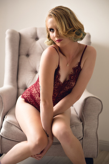young girl sitting in lingerie