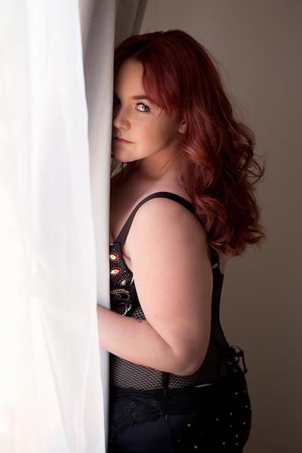 boudoir hiding at window