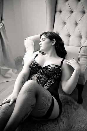 leaning back onto chair boudoir corsett photo