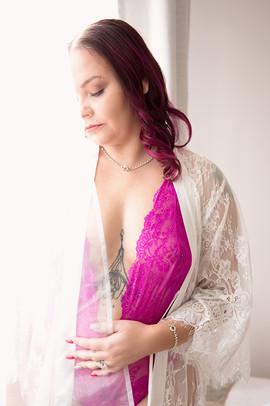 boudoir pink lingerie at window