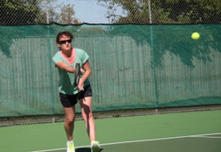 Beth playing a forehand