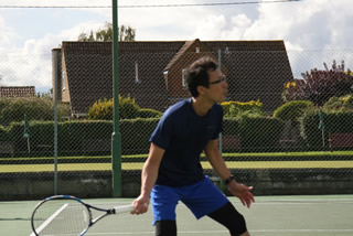 Tomo hitting a forehand