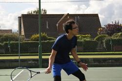 Tomo hitting a forehand