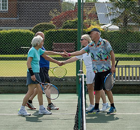 Mixed doubles players shake hands after a match