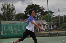 Tomo playing a volley