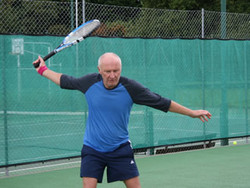 Matthew sets up for a forehand