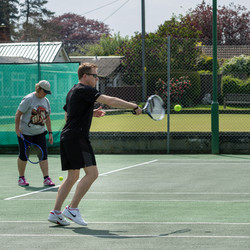 Adam playing a volley