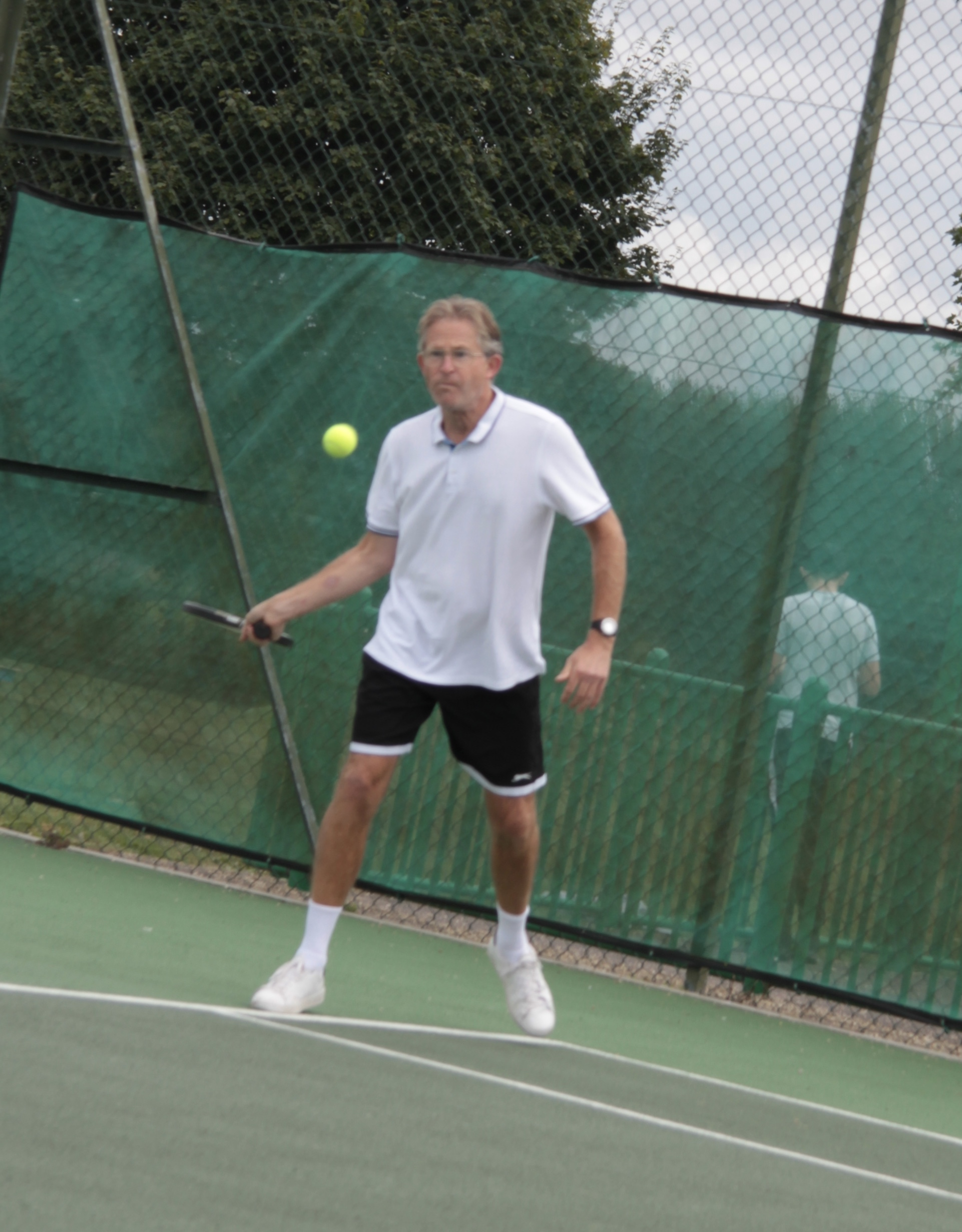 Charles playing a forehand