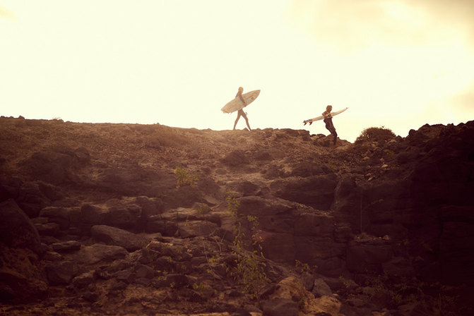 surfers on rock.jpeg