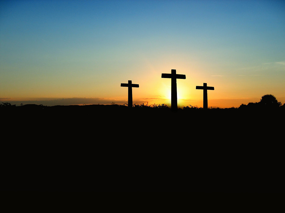 silhouette-photo-of-3-cross-under-the-bl