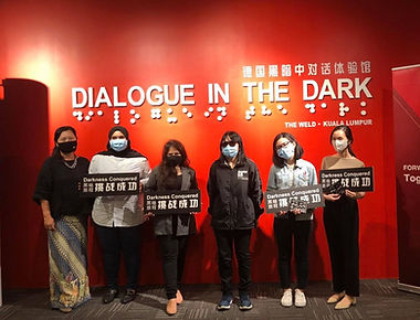 Visitors all donned with masks takes a group photo after the Dark Tour