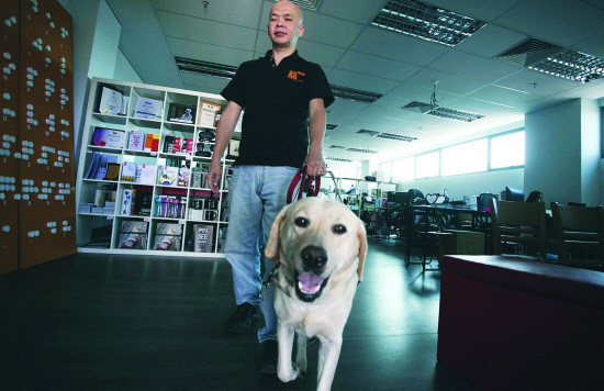 Dialogue in the Dark Malaysia Founder Stevens Chan, with his guide dog LaShawn