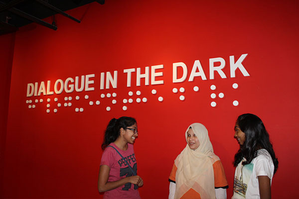 Visitors thanking Nor Aisyah, after the 45-minute 'Cuti-cuti Malaysia' journey in total darkness.