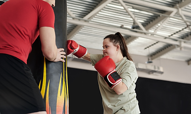 A girl with developmental disability training for kickboxing
