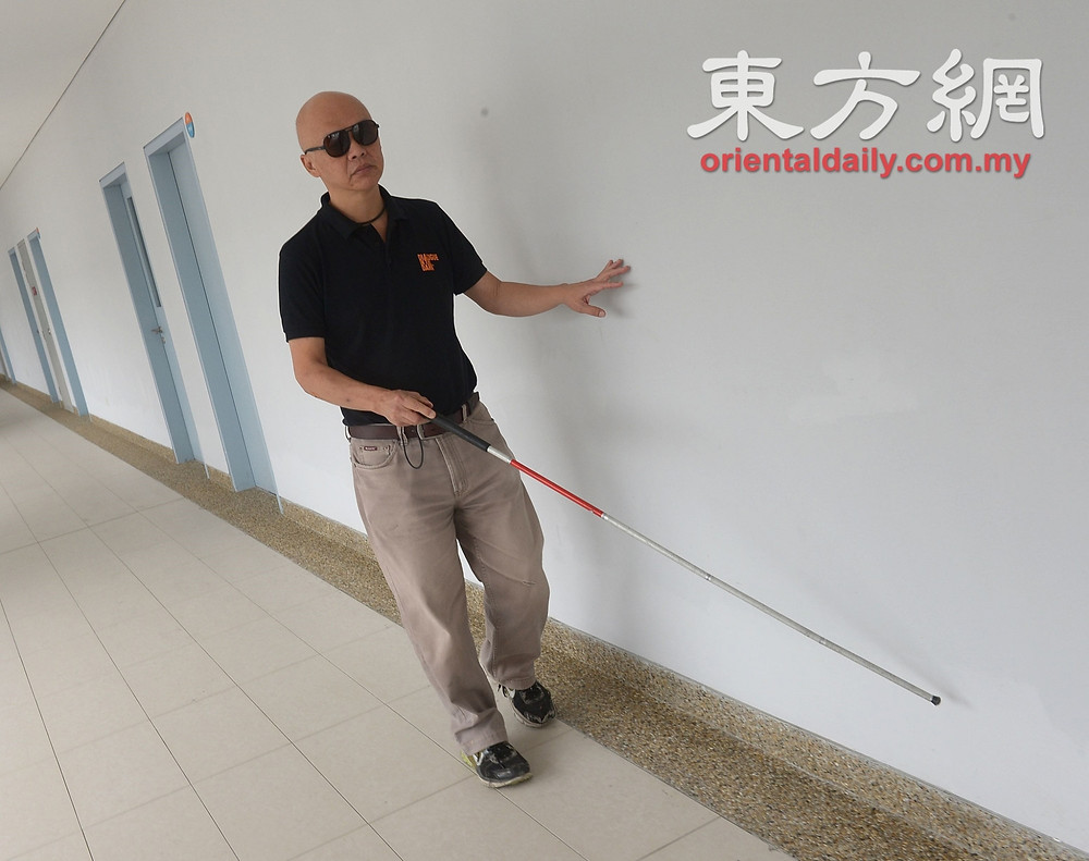 Stevens, founder of Dialogue in the Dark, using his white cane as he walks