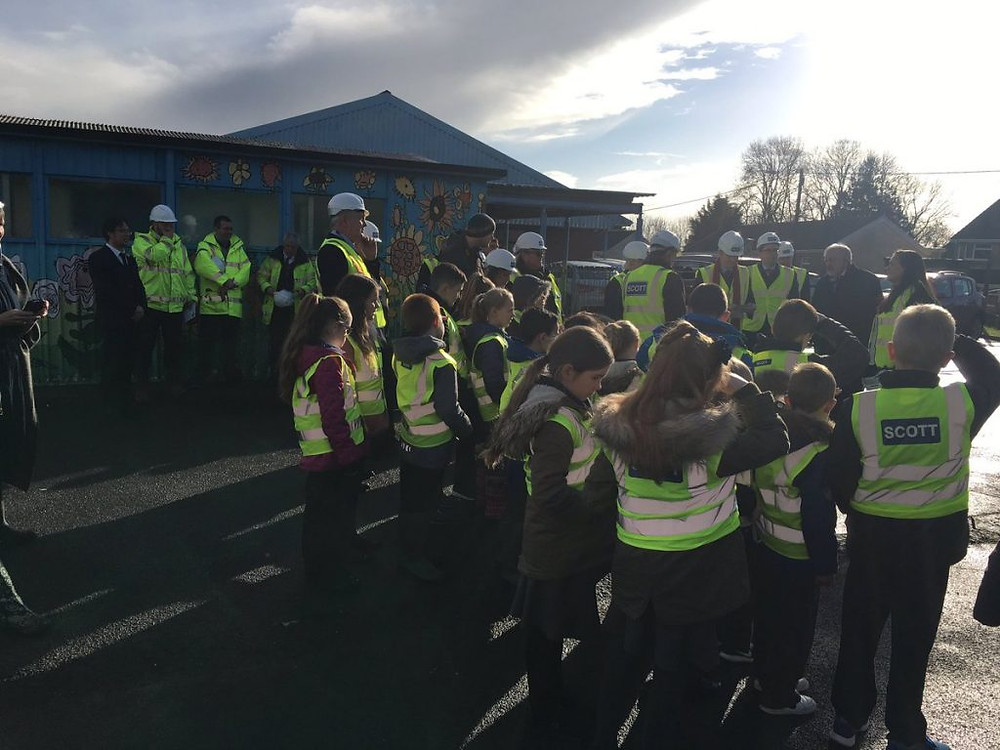 group children high vis and officials