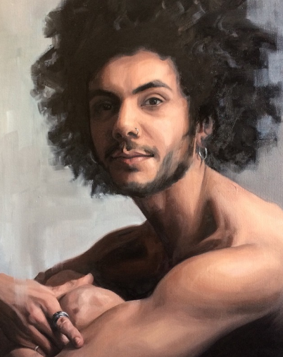 Portrait of man with nose piercing, beard and curly hair