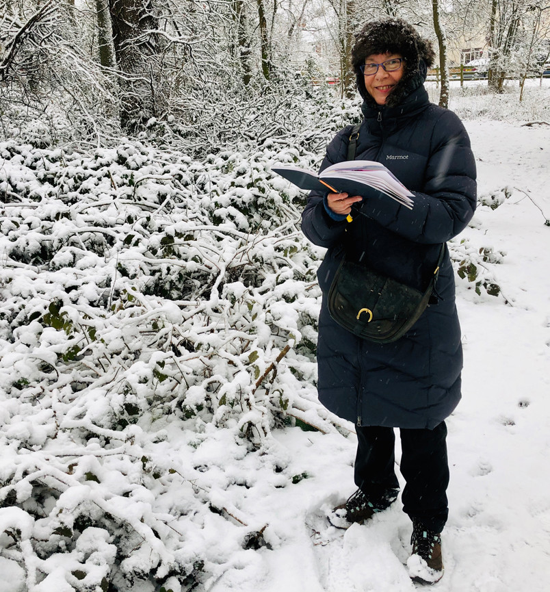 Linda Nevill sketching in the snow