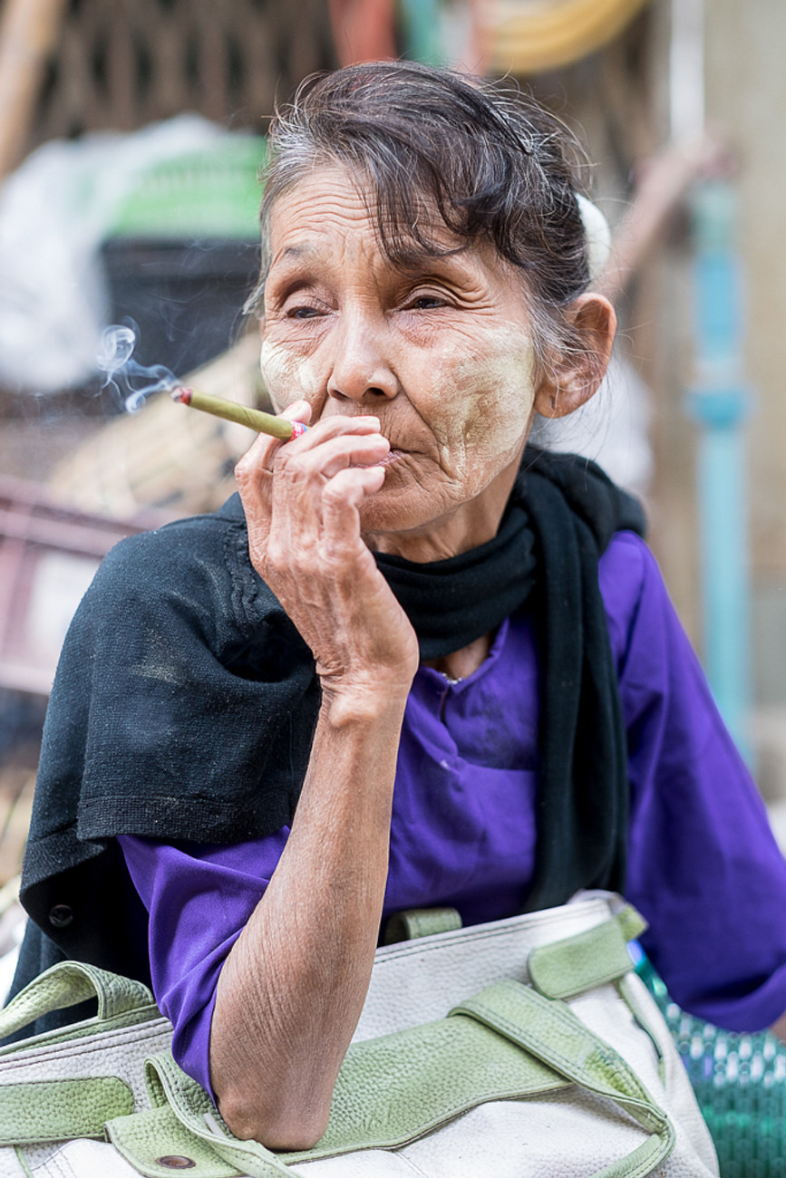Elderly woman smoking a cigar in Myanmar