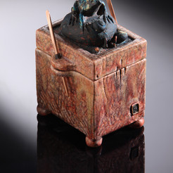Raku form with cast glass frog