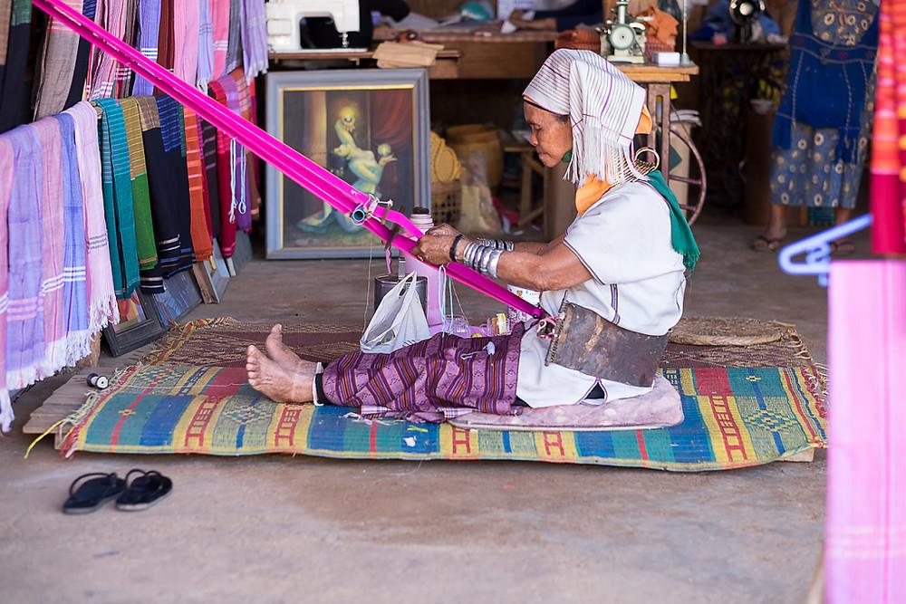 Woman weaving by Olivia Swinscoe