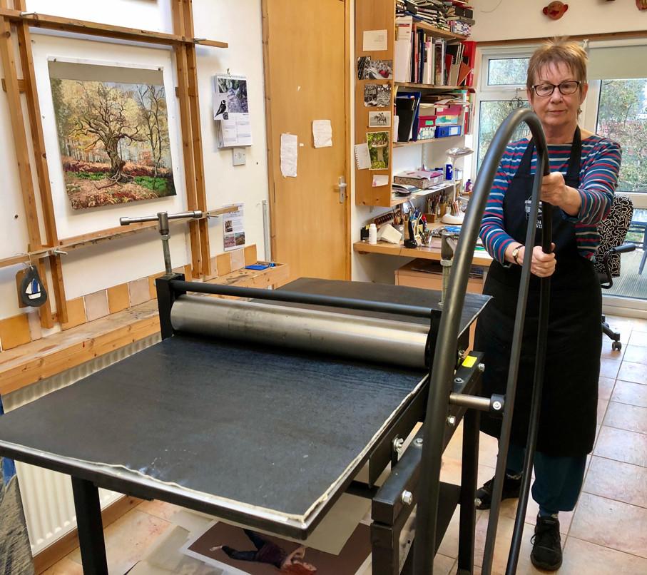 Linda Nevill using her etching press