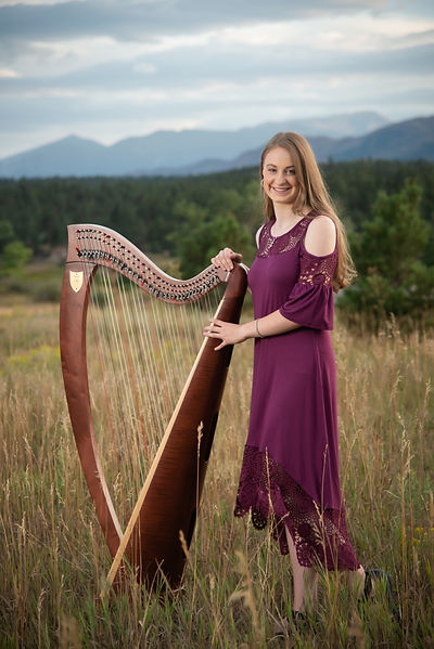 Colorado Springs Harpist in field near United States Air Force Academy