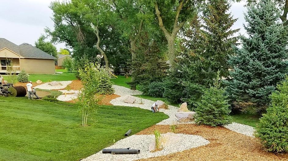 Trimming sod around custom landscaping