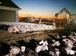 Landscaping Quartz Boulder Wall Dusk_edited.jpg