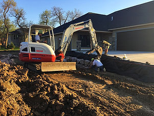 quartzite boulder wall construction mini excavator_edited.jpg