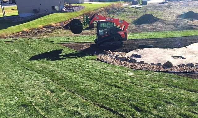Premium Sod put down with our Kubota track skid