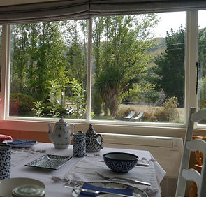 Looking into the garden from the breakfast room at Pip's Orchard in Gibbston Valley