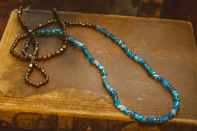 Blue brass toned necklace