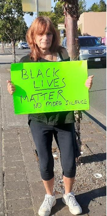 Lisa Stiller with Black Lives Matter sign