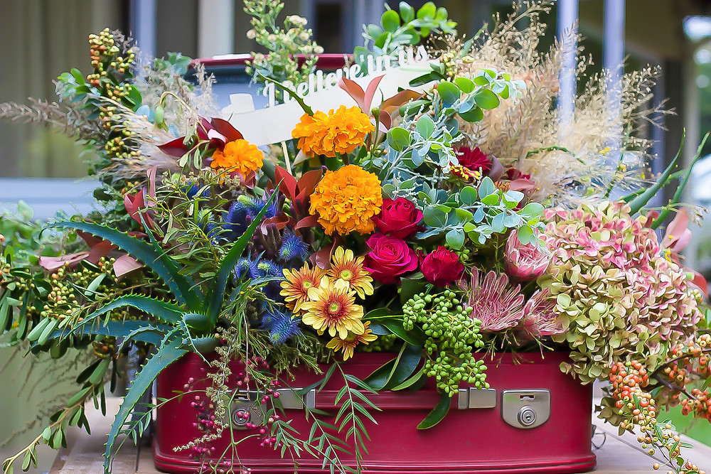 Wedding flowers in vintage suitcase