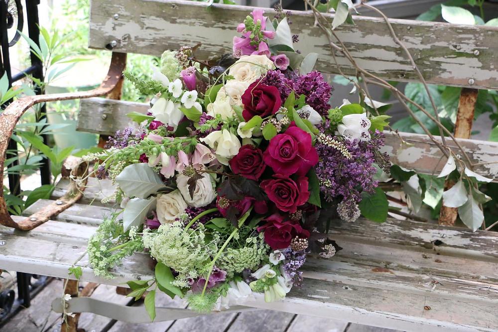 Wild flower bouquet on a bench