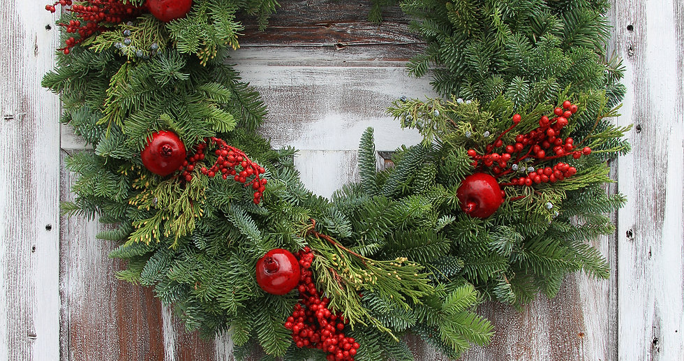Christmas wreath on a rustic wooden fron
