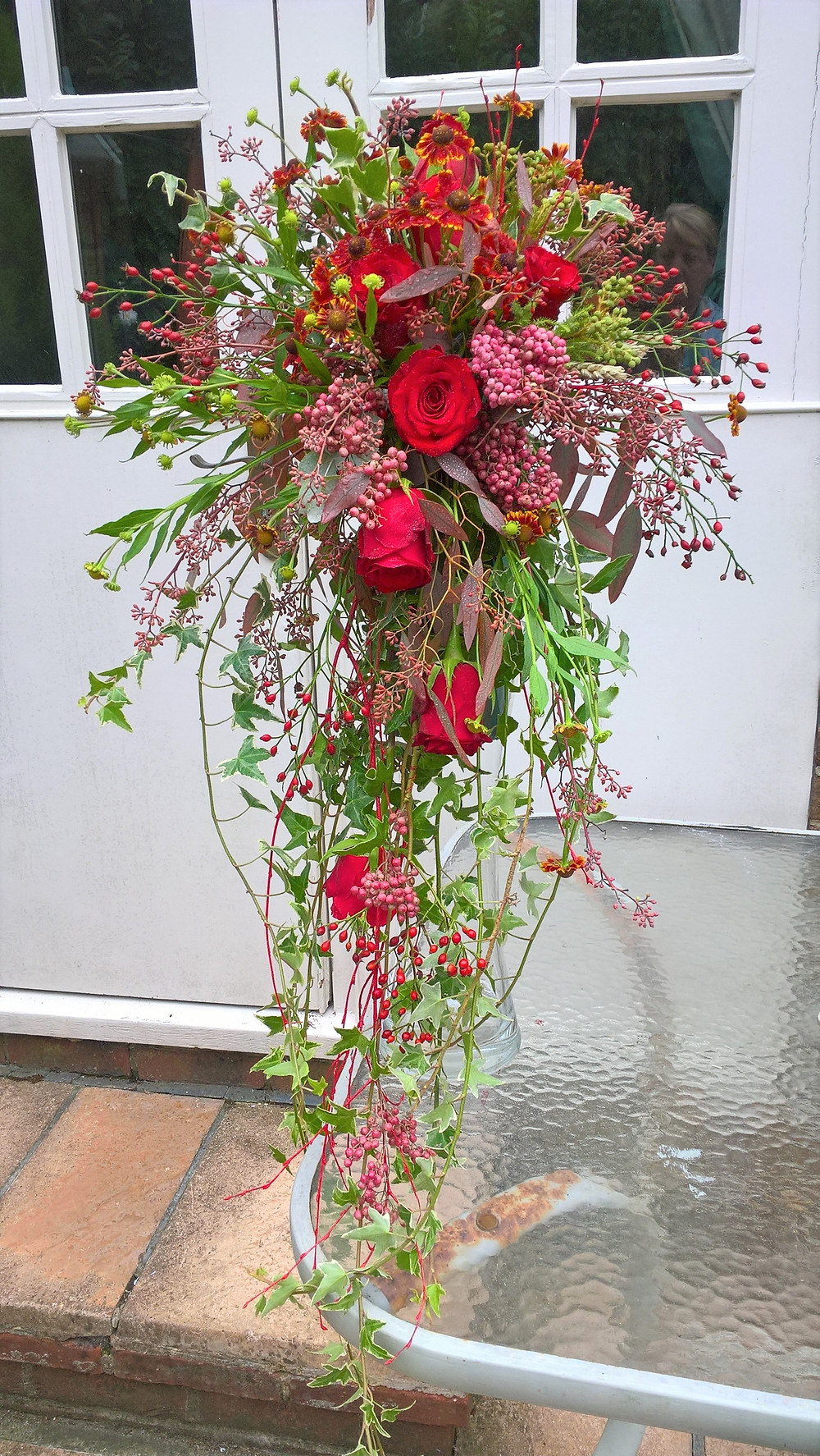 Roses, pink peppercorns and helenium wedding bouquet