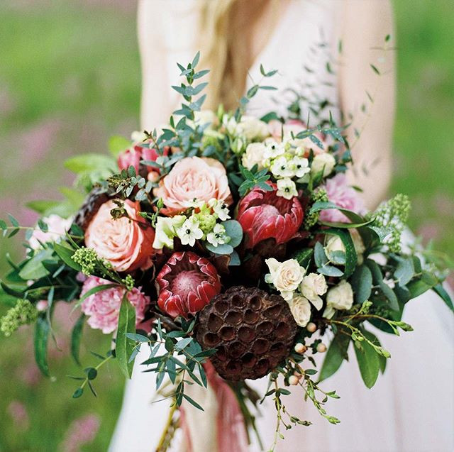 Lotus seed pos and protea wedding bouquet