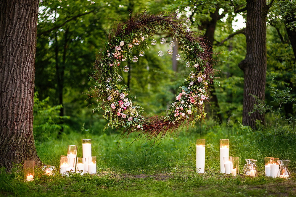 Ask your florist to create a Ceremony Arch or a Hanging Willow Circle in your garden   ( perfect for the first kiss photo!)