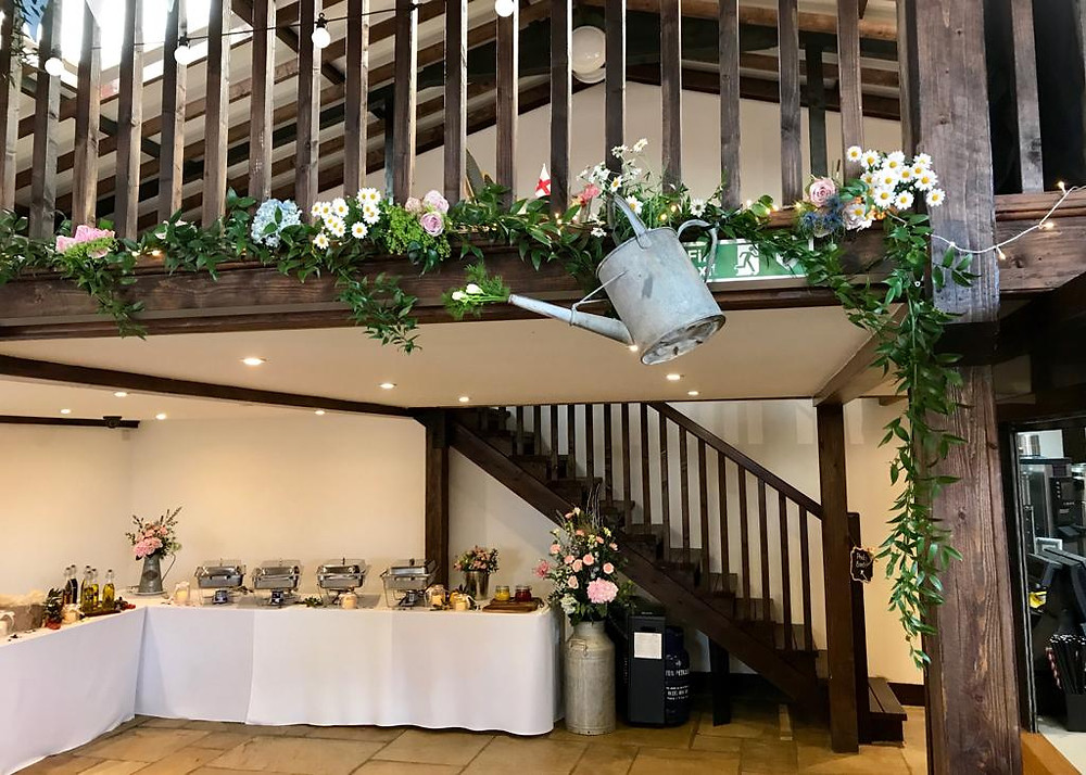 Watering cans were used throughout the venue, filled full with blooms or hanging as though they were watering the Guests!