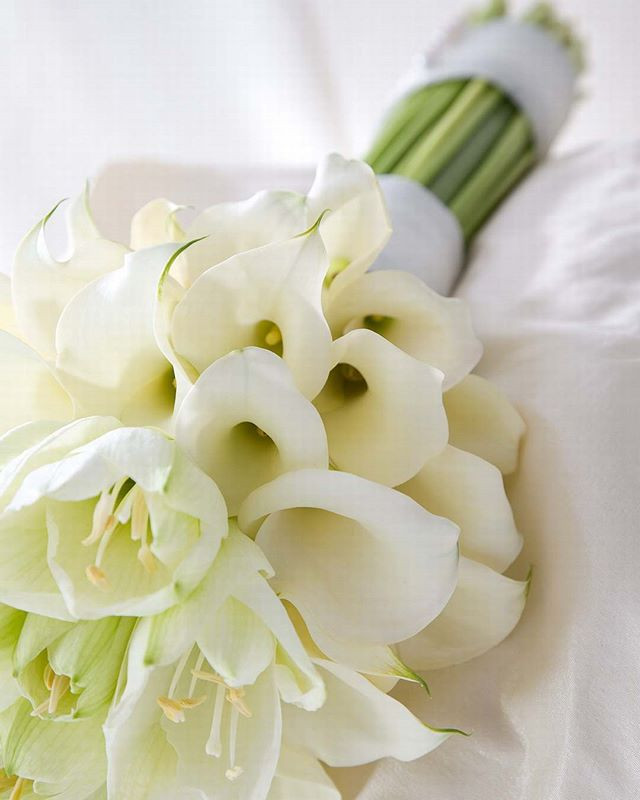 White calla lily and amaryllis wedding bouquet