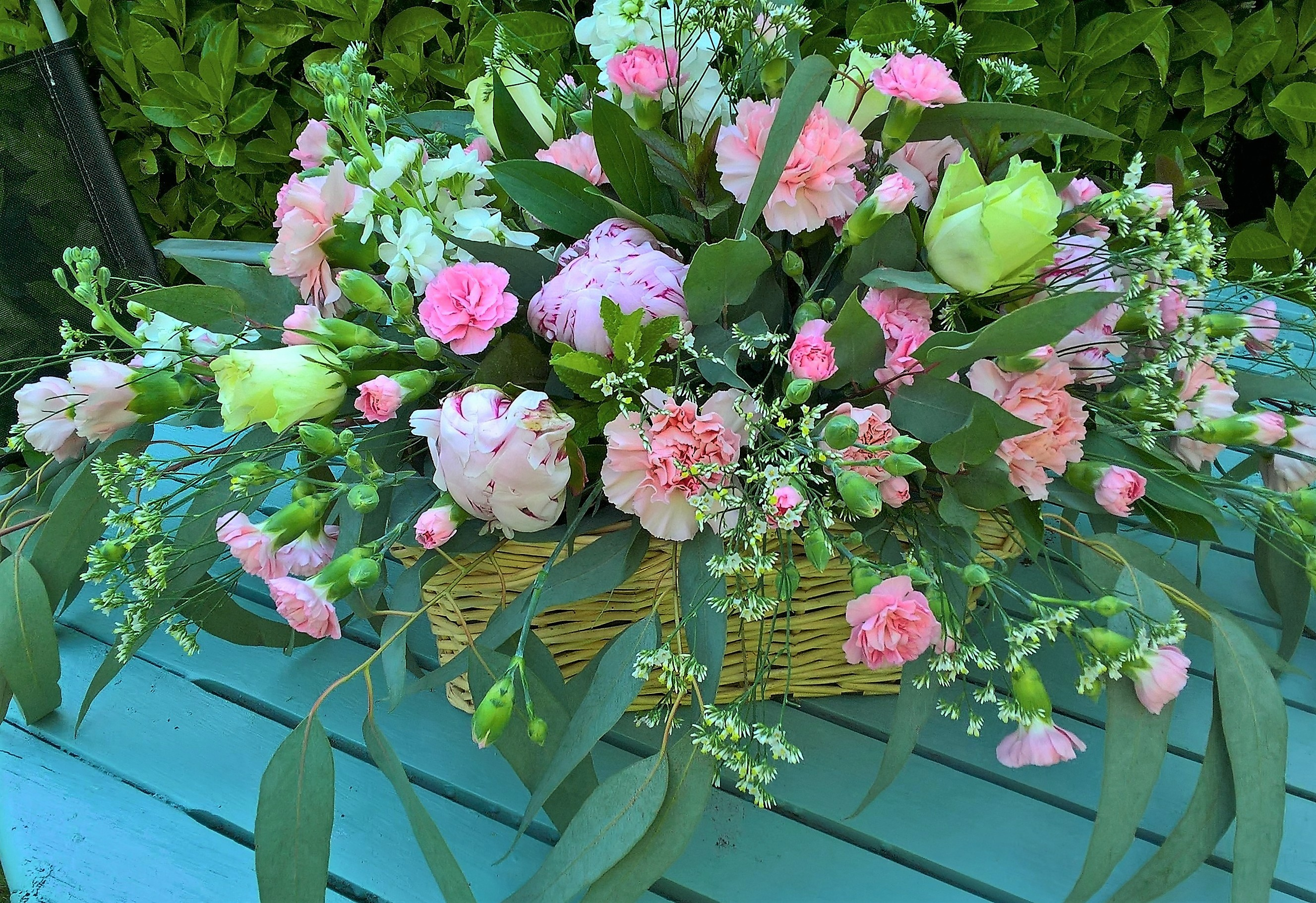 Basket of peonies and carnation