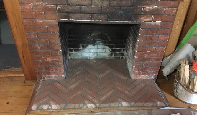 Hearth Rebuilt In Herringbone Pattern