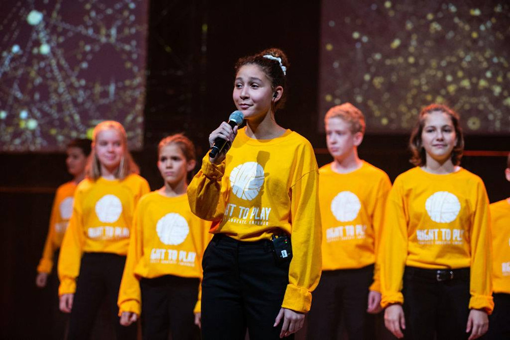 Children Singing with yellow sweaters